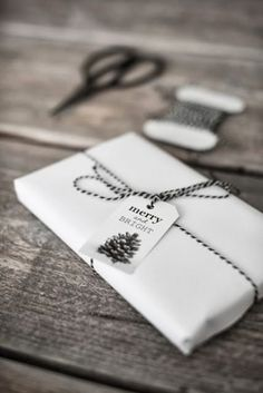 Wrap your gifts in plain white paper then add a touch of black for sophistication // gift wrapping ideas Wrapping Ideas, Wrapping Gift, Creative Gift Wrapping, Christmas Gift Wrapping, Christmas Packages, Christmas Presents, Winter Christmas, All Things Christmas, Christmas Holidays