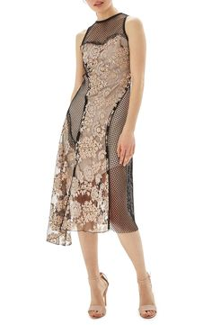 Nice mix of mesh and a feminine lace. Looks fitted, as well.