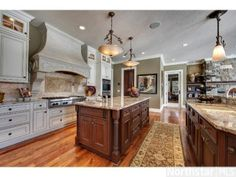 This kitchen features unparalleled elegance and Tuscan charm.