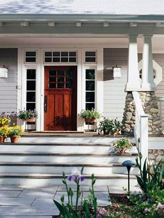 fabulous-ness! Love the porch, the columns with the rock, the painted & stained steps...<3 <3 <3