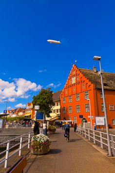 A zeppelin flying above Lake Constance (Bodensee) at Meersburg, Baden-Württemberg, Germany