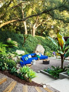 In the front garden Katie sits on a custom curved sectional covered in a Sunbrella fabric. Fire pit by WP Thatcher Design.