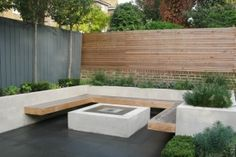 Horizontal fence + painted vertical fence. Raised bed, built-in bench and firepit
