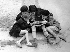 Children Reading the Newspaper, Paris, 1936 - Paris in 1930s by Fred Stein