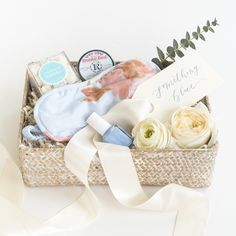 """The search for that perfect """"something blue"""" is over! Marigold & Grey's signature """"Something Blue"""" gift box design is an updated version of their original, sure to be adored by all brides-to-be! Perfect as a bride to be gift, engagement gift, thank you gift, wedding welcome gift, hostess gift, bridesmaid gift, housewarming gift, client gift, corporate gift, bridal shower gift and more!  Source: https://www.marigoldgrey.com/shop/pre-designed-gifts.html"""