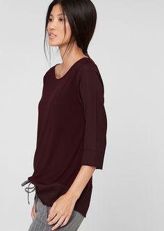 T-Shirt mit 3/4-Arm Jerseyshirt mit Ärmel und Saum aus Chiffon. Paspelierter Ausschnitt mit Cut-out und Knopf im Nacken. Ärmel in 3/4-Länge. Verlängerte, lockere Passform; Rückenlänge bei Größe 36 ca. 72 cm. Anschmiegsamer Materialmix. Blusenshirts kann man elegant wie auch lässig stylen. Sie passen sich perfekt Ihrem Look an..  Materialzusammensetzung:Obermaterial: 100% Viskose, Blenden: 100% ...