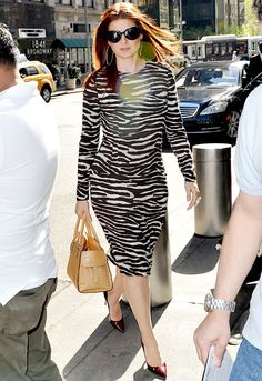 WHO:Debra Messing  WHAT:Michael Kors teak and ivory zebra printed stretch cady long sleeve sheath from the Spring 2012 collection and a suntan crocodile-embossed Gia Satchel from the Fall 2011 collection  WHERE:New York City  WHEN:April 17, 2012