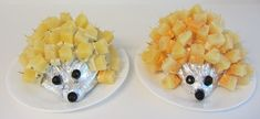 It's a British thing! Cheese and Pineapple Hedgehogs (or Porcupines). A cabbage cut in half, wrap in tin foil, add cheese and pineapple chunks on cocktail sticks for spines, olives for eyes and nose. You can also use a potato for the body. I used a mild cheese for one and a hot Mexican cheese for the other, fun for parties! Cheese and Pineapple go well together.