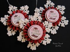 Ornaments using store bought snowflakes, rosettes cut with my @Cricut, and a stamp by @JustRite Stampers
