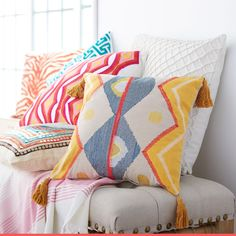 A pop of color and comfort, cover every surface in cotton throw pillows.