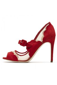 Red shoes are always fabulous, but I love the scalloped vintage look of these.