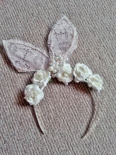 Cream and white lace bunny ears with pearls and paper roses