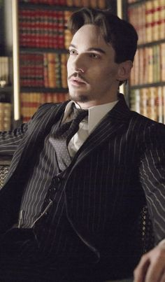 Jonathan Rhys Meyers I want him and this library!