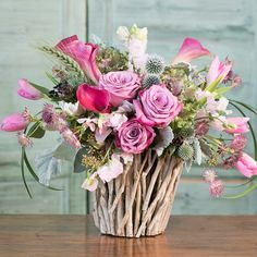 This wild flower queen of hearts has lavender roses, calla lilies, tulips, thistle and other flowers in a twig vase. Handcrafted by Eiji's Florist in La Canada, CA.