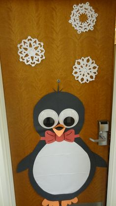 Cute holiday decoration for my dorm door I made with large googly eyes!
