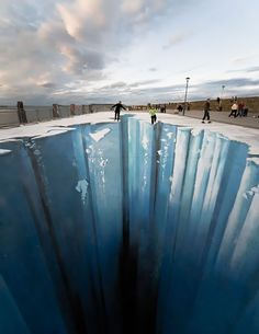 Um, wow!  3D sidewalk chalk art.