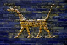 Detail of the Babylonian Ishtar Gate depicting the principal Babylonian deity Marduk, with its typical serpent's head, viper's horns, scorpion's tail, front feline paws and rear bird claws.    These polychrome relief tiles were excavated in the 1930s by the German archaeologist Robert Koldewey. The tiles were completely shattered, requiring around two years to clean, preserve and reassemble.