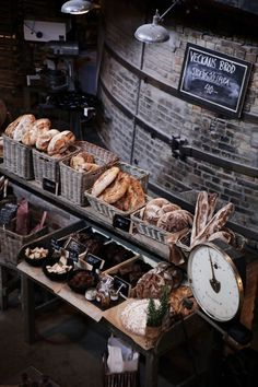 the brick wall, the baskets, even the rosemary in a simple paper bag ... love the rustic, industrial feel