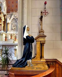 St Rita of Cascia | saintnook.com/saints/ritaofcascia |  File:Sainte Anne de Detroit Catholic Church (Detroit, MI) - interior, statue of St. Rita.jpg