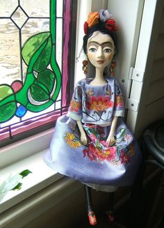 Frida Kahlo is best known for her self portraits. I feel a deep connection to Frida because we share a lot. I understand her loneliness and pain that translates into art, sometimes the only way to express deep unwordable feelings. Blue - Frida Kahlo again appears A tribute to the famous artist.    This listing is for one custom doll. She is one of a kind art doll, made without use any molds.  She is sculpted of papier mache and paper clay over a wire armature. Her silk dress has hand-painted…