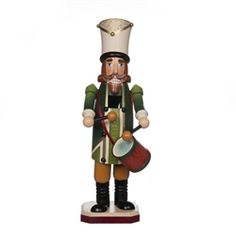 "Drummer Nutcracker 11-1/2"" h The handcrafted and splendidly colored workmanship of a royal Drummer ""Drumming"". Each nutcracker in this series has a numbered brass plate under the base."