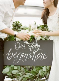 """""""Our Story Begins Here"""" #signage   Photography: KT Merry Photography - ktmerry.com  Read More: http://www.stylemepretty.com/2014/05/05/wildly-romantic-santa-barbara-engagement/"""