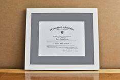 "Style: Medium Frame Color: White Mat: 2"" Gray Diploma: 11"" W x 8 1/2"" H"