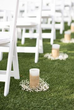 """DIY aisle markers with candles + baby's breath!  So easy to make but they look so naturally beautiful and are the perfect frame for your """"walk down the aisle."""" Taken at THE SPRINGS in Angleton, Magnolia Manor.  Follow this pin to our website for more information, or to book your free tour! Photographer:  Southern Pines Photography #aislemarkers #diyaislemarkers #diyweddingdecor #diywedding #diyweddingdecorations #diyweddingceremony #diyceremony #diybride #houstonbride #houstonwedding"""
