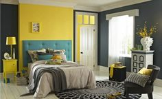 I like how there's a yellow accent wall, and then the headboard is another color. I love this room