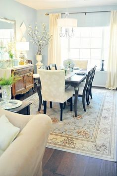 Dining Room. love blue dining room. mixmatch light and dark chairs and table with two print chairs at the end
