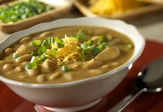 Campbell's® Condensed Cream of Chicken Soup and dry onion soup and recipe mix combine to flavor this scrumptious chili featuring chicken, white kidney beans and chili powder, and served with shredded Cheddar cheese and sliced green onion.
