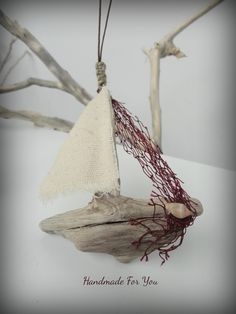 Long necklace with driftwood ship.