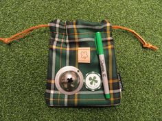The first venture between our friends, Seamus Golf and Tin Cup - Irish National tartan valuable pouch with Luck of the Irish Tin Cup - on sale soon at www.tin-cup.com Luck Of The Irish, Lunch Box, Pouch, Tartan, Tin, Golf, Friends, Amigos, Sachets