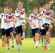 Knees up: Mesut Ozil (left), Bastian Schweinsteiger (centre) and Erik Durm (right) jump up...