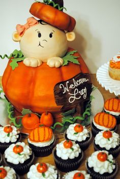"""Pumpkin """"baby"""" cake. Totally inspired by """"MissMona"""" on CC. So much fun to make. The pumpkin is made up of 2 - 12"""" cakes and 2-10"""" cakes. I used the Wilton round ball pan for the head and just a 6"""" carved cake for the hat. There also is a board between the cakes in the pumpkin with dowels and 2 dowels going through the head one for the hat and one to hold the head in place. xo"""