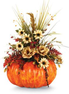 White Pumpkin filled with all sorts of fall foliage and dried flowers or similar to create a wedding fall theme that isnt Halloween-ish