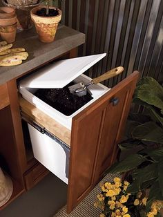 Add-on to a potting bench for gardening soil. (Waypoint potting bench shown in style 430F, Maple Auburn)