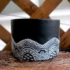 polymer clay cuff (great idea to take plain coloured wide bangles and either wrap or glue lace to it)