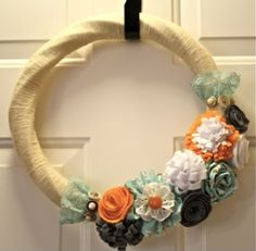 Flower Spring Wreath @ Sugerbaby Boutique. I love her colors she used for the wreath.
