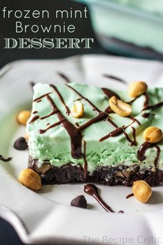 Frozen Mint Brownie Dessert at https://therecipecritic.com These will become an instant favorite with layers of brownie and a creamy mint, these are amazing!