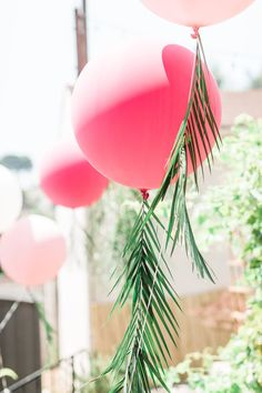 Pink jumbo balloons with palm leaf tails from a Tropical Birthday Party on Kara's Party Ideas | KarasPartyIdeas.com (13)
