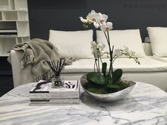 BoConcept Notting Hill Showroom - Understated Luxury; Use of BoConcept accessories for contemporary flower arrangement;
