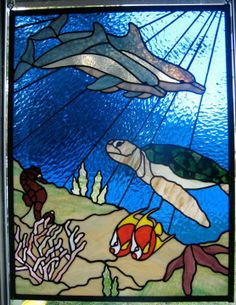 Undersea with dolphins, turtle, seahorse, fish, starfish, coral by Keili Graves