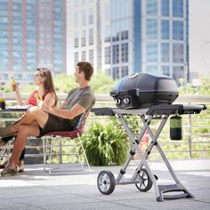 Napoleon's TravelQ™ PRO285 Portable Propane Gas Grill with scissor cart can grill up to 20 hamburgers at once on the 285 square inches of cooking area. The stylish all-black finish with chrome details will match any outdoor decor. The cast aluminum, high-topped lid design lets you take portable grilling to the gourmet level. Roast whole chickens or turkeys, pork and even prime rib; this little grill can do it. Propane Gas Grill, Portable Grill, Built In Grill, Grilling, Bbq Grill, Napoleon, Backyard, Patio, Crowd