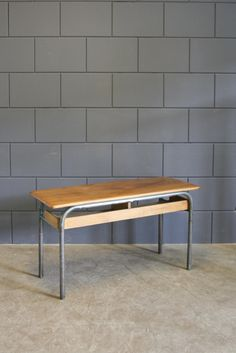 Best of the Past - Industrial Vintage school desk from the North of France, with original wooden top and steel frame. Makes me wonder how many hours of education and generations of students this desk has dealt with...it still looks great ; )