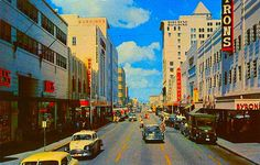 1950s Miami FL, Flagler Street. Look at those store signs...Woolworth's, Grant's, McCrory's...such a neat time capsule.