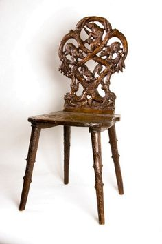 A 19th century Swiss carved Black Forest side chair