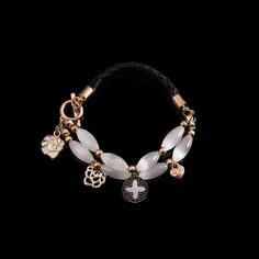 Curat Glamour Charm Bracelet ~$24.00 Show off your lively and vibrant personality with this unique charm bracelet featuring heart, flower and cross charms http://www.muwae.com/shop/curat-glamour-charm-bracelet