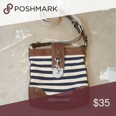 Chaps Navy Brown and Cream Crossbody Bag I am selling a cute and simple crossbody bag by Chaps.  I bought for those days I wish I were in the Hamptons on a yaht, (Lol) and I've worn on days when a small-ish crossbody bag is all I want to carry.  Perfect for baseball games or afternoons at the park.  Excellent condition, and very preppy chic in this nautical color pallette.  Very minimal wear on strap, (see last few pics.) Chaps Bags Crossbody Bags