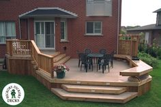 This two level deck is made with smooth sandlewood coloured EZ Deck. in size, this classy deck can be found in Oakville, Ontario. EZ Deck never needs staining so it pays for itself in a few years with the maintenance savings. Deck With Pergola, Pergola Patio, Backyard Patio, Patio Deck Designs, Patio Design, Railing Design, Two Level Deck, 2 Level Deck Ideas, Landscaping Around Deck